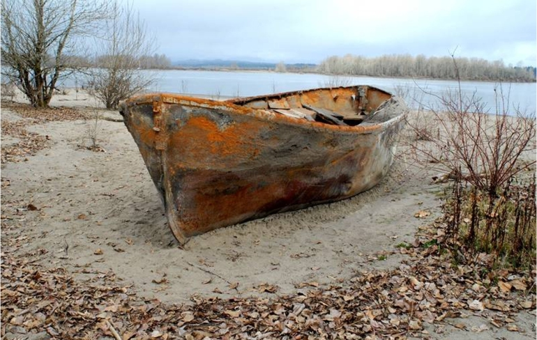 rusty-lifeboat-on-beach